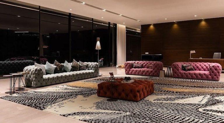 Baxter sofas, Cattelan Italia end tables, Arcedior rug, floor lamp from Secto Light